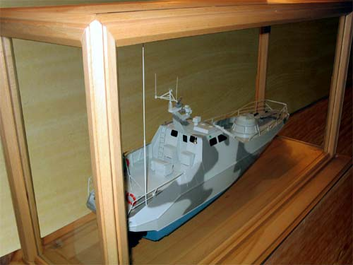 Scale model of patrol boat Harpoon, stand and display case